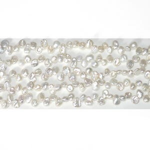 White Freshwater Pearl Keshi Style Beads Approx 7 x 9mm Strand Of 65+ Pieces FP1724