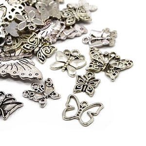 Antique Silver Tibetan Zinc Mixed Butterfly Charms 5-40mm Pack Of 30g HA06700