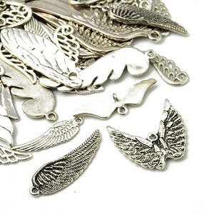 Antique Silver Tibetan Zinc Mixed Wing Charms 5-40mm Pack Of 30g HA07035
