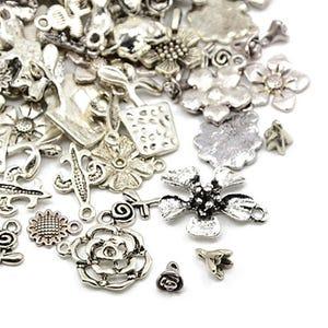 Antique Silver Tibetan Zinc Mixed Flower Charms 5-40mm Pack Of 30g HA07045