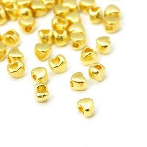 Gold Tibetan Zinc Heart Spacer Beads 3mm x 4mm Pack Of 100+ HA15460