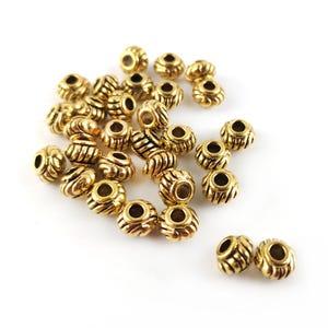 Antique Gold Tibetan Zinc Rondelle Spacer Beads 4mm x 6mm Pack Of 30 HA15975