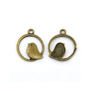 Antique Bronze Tibetan Zinc Bird Pendants 25mm Pack Of 10 Y08760