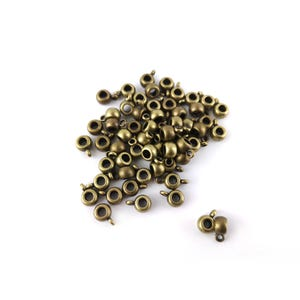 Antique Bronze Metal Alloy 6mm x 9mm Round Charm Hangers Pack Of 50+ Y11600