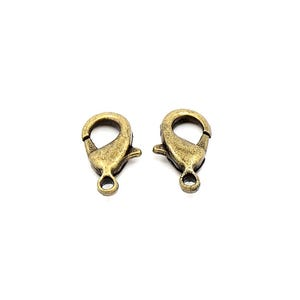 Antique Bronze Brass 7mm x 12mm Lobster Clasps Pack Of 30 Y11715