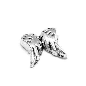Silver Tibetan Zinc Angel Wings Floating Charms 6.5mm x 7mm Pack Of 10 Y13920