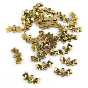 Antique Gold Tibetan Zinc 20mm x 10mm Bow Connectors Pack Of 30 Y15525