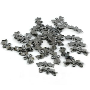 Black Tibetan Zinc 20mm x 10mm Bow Connectors Pack Of 30 Y15595