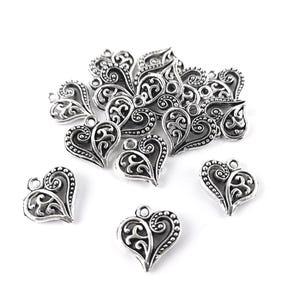 Antique Silver Tibetan Zinc Heart Charms 14mm Pack Of 15 ZX03235