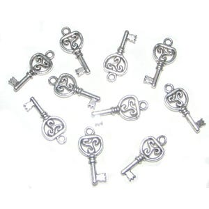 Antique Silver Tibetan Zinc Key Charms 21mm Pack Of 20 ZX03250