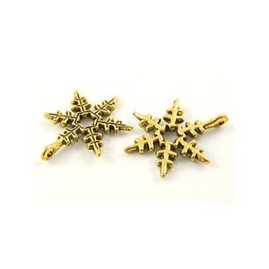 Antique Gold Tibetan Zinc Snowflake Charms 24mm Pack Of 10 ZX08400