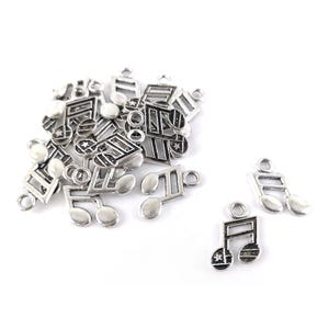Antique Silver Tibetan Zinc Music Note Charms 19mm Pack Of 20 ZX09365
