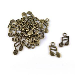 Steampunk Antique Bronze Tibetan Zinc Music Note Charms 19mm Pack Of 20 ZX09670