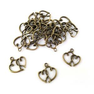 Steampunk Antique Bronze Tibetan Zinc Heart Charms 20mm Pack Of 20 ZX14655