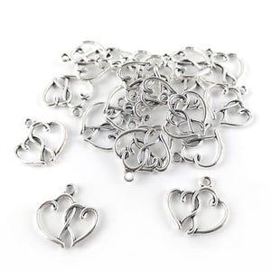 Antique Silver Tibetan Zinc Heart Charms 20mm Pack Of 20 ZX14940