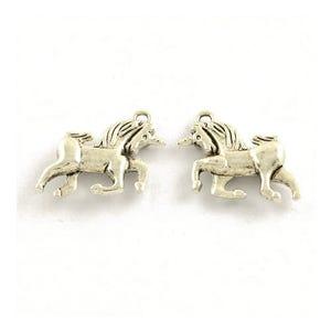 Antique Silver Tibetan Zinc Unicorn Charms 21mm Pack Of 15 ZX15820