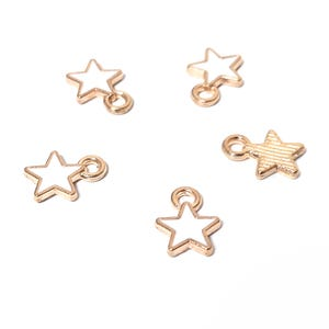 Gold/White Enamel & Alloy Star Charms 6.5mm x 8.5mm Pack Of 5 ZX19150